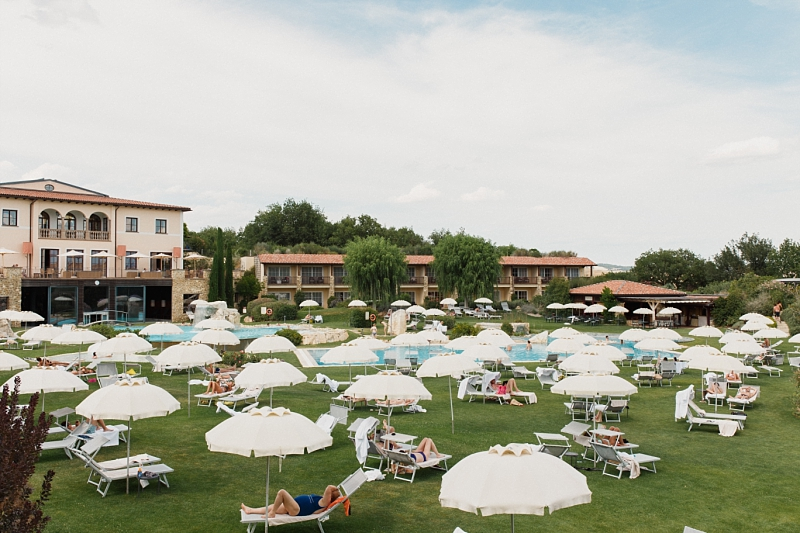 wedding guests chilling at adler thermae in val d'orcia