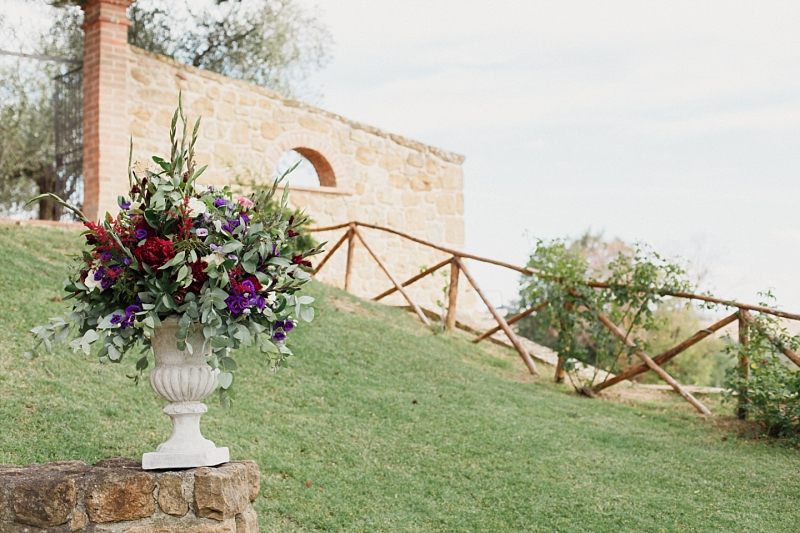 wedding flowers on stone stairs leading to ceremony