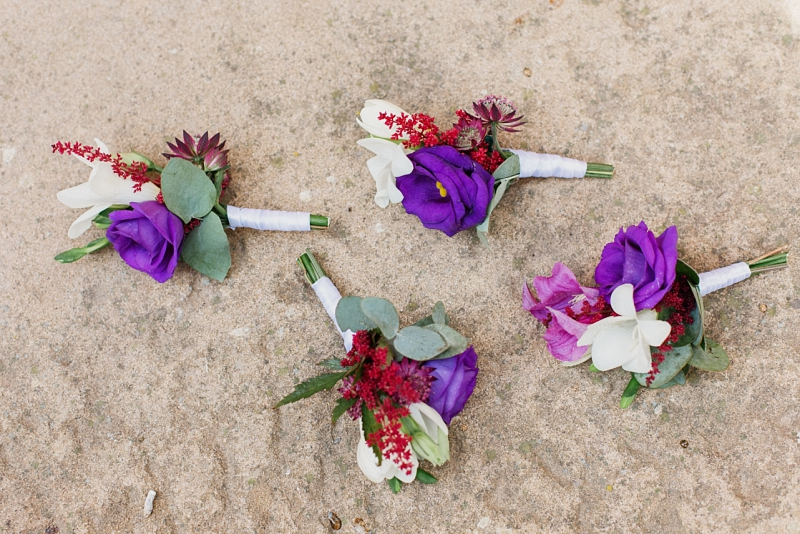 groom and groomsmen ultraviolet boutonnieres