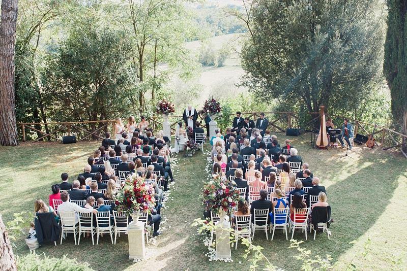 dreamlike outdoor wedding ceremony setting in tuscany