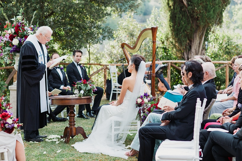 priest reading at wedding ceremony in val dorcia