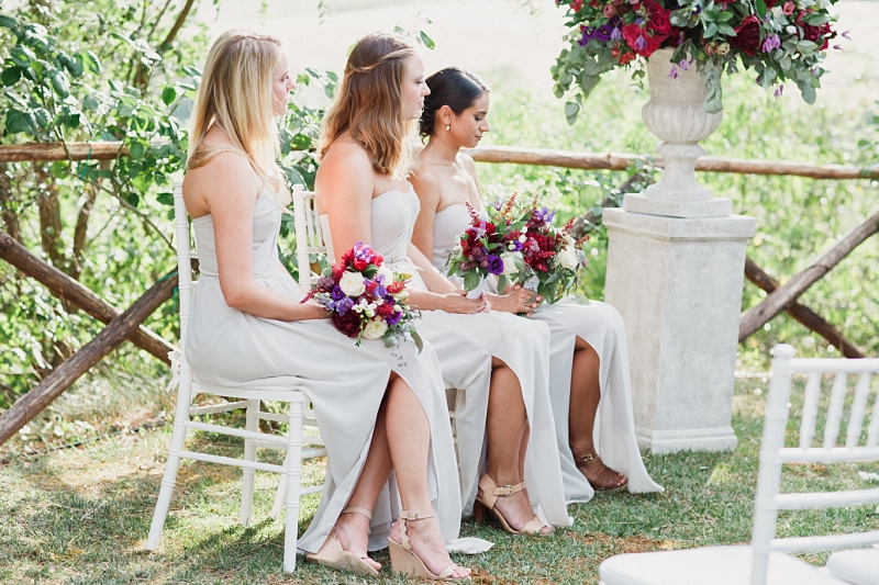bridesmaids with flower bouquets in val d'orcia