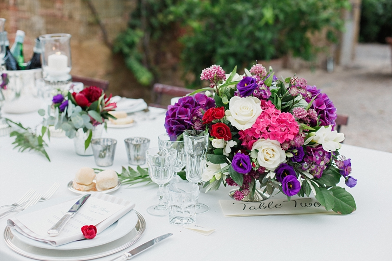 colourful wedding centerpiece in tuscany