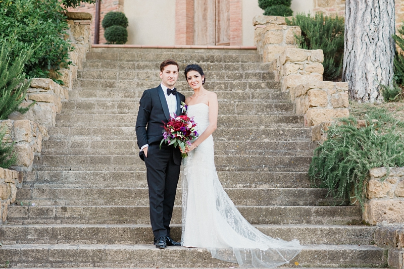 fine art bride and groom portrait on stone stairs