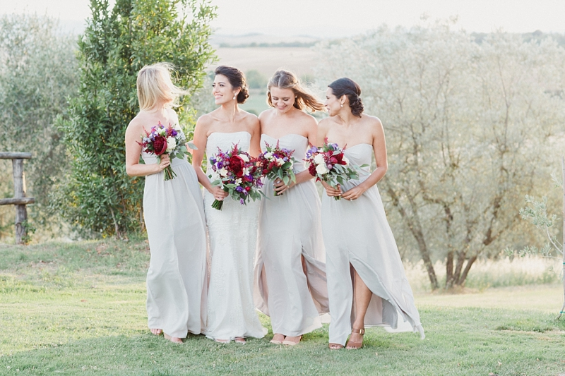 bride and bridesmaids smiling at each other